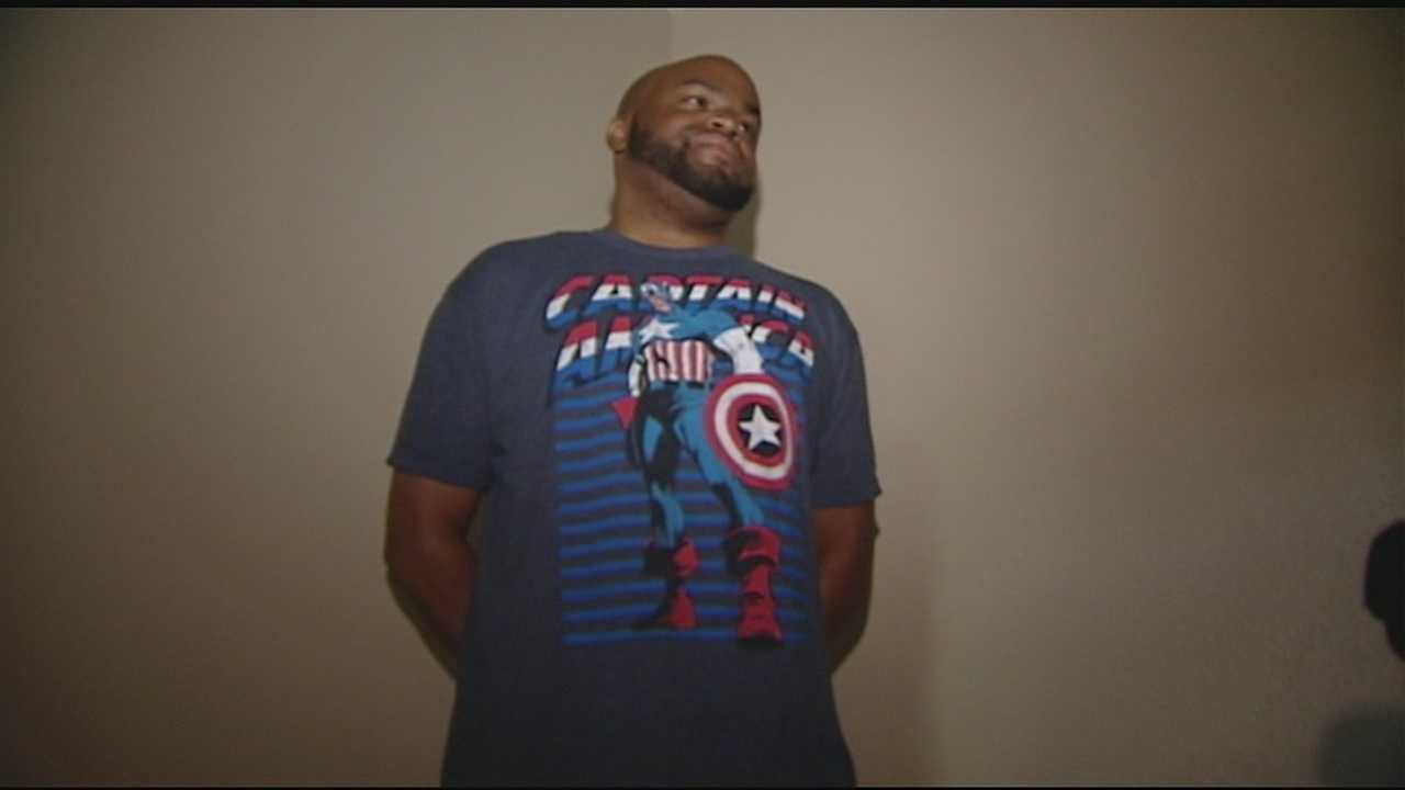 A man wearing a Captain America shirt saved a 10-year-old boy from the bottom of a pool in Forest Park Thursday.