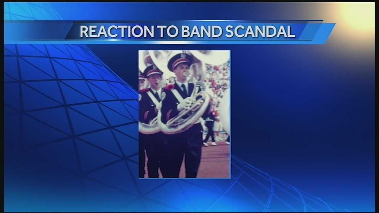 On Friday, the fired band director vowed through his attorney to fight his dismissal in an effort to reclaim his reputation.