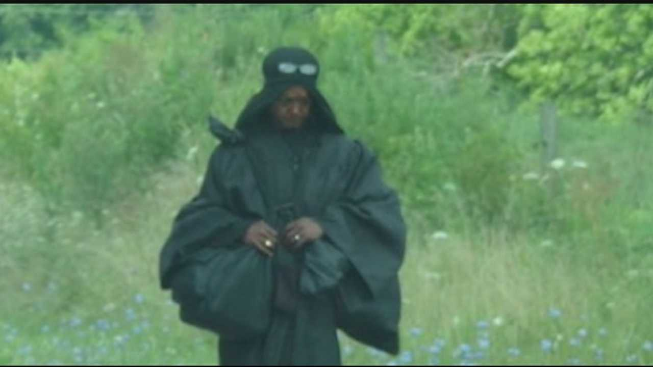 The woman in black's wandering has led to lots of wondering as she passed through Highland County dressed in all black with a robe and head covering, apparently on some unknown mission.