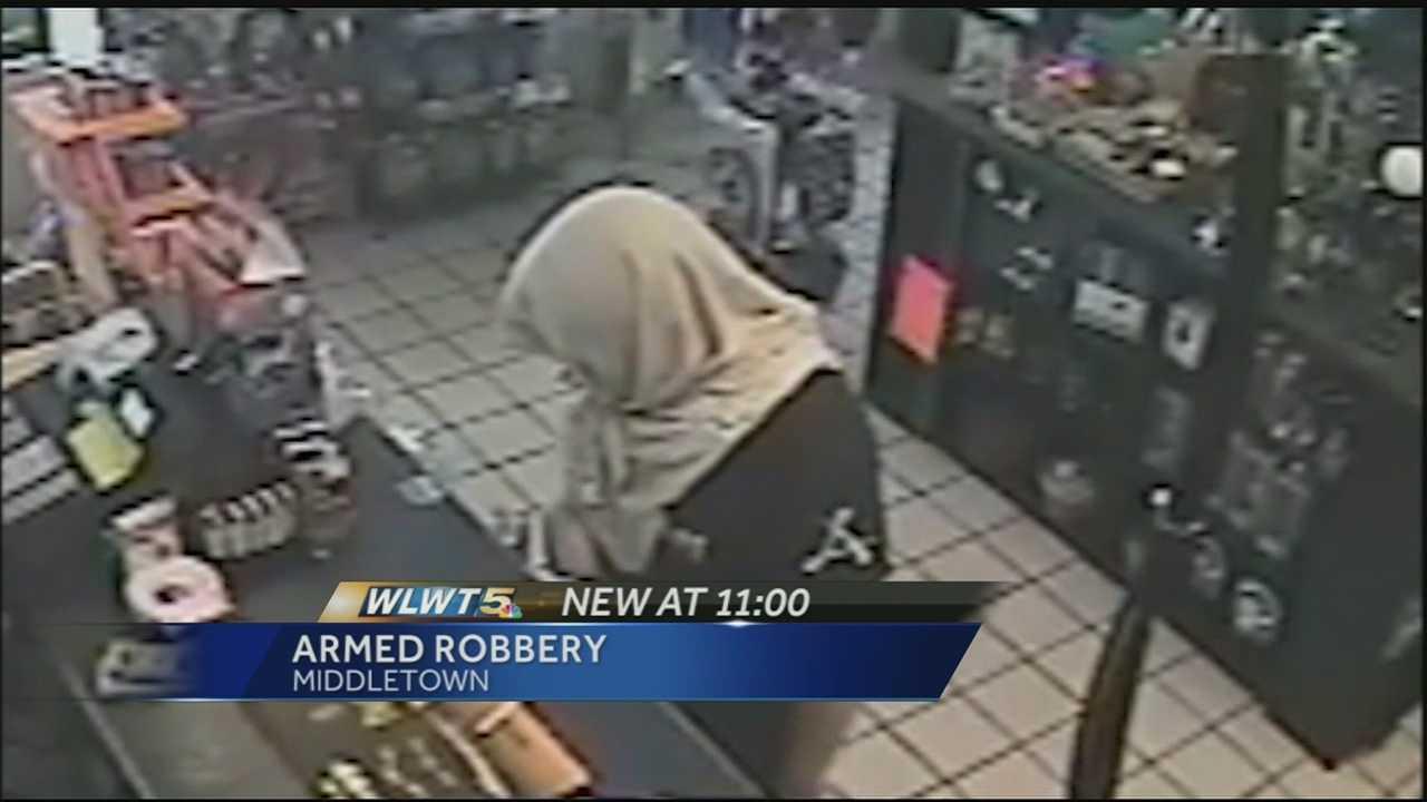 090314 shirt on head robber
