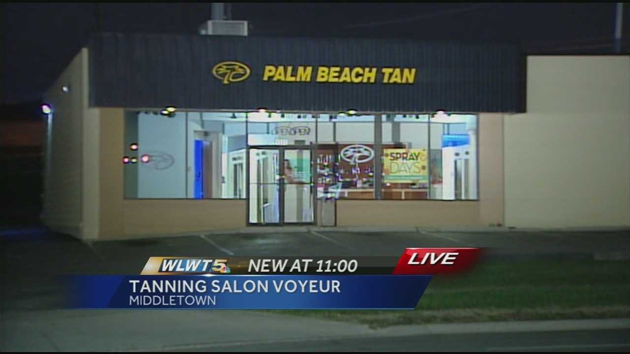 The victim told police she was tanning at the Palm Beach Tan on Elliot Drive when a man with a cellphone held his phone over the partition between tanning booths and recorded her.