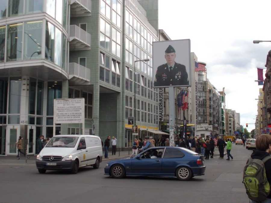Checkpoint Charlie became the most recognizable crossing between East and West Berlin. A portrait of an American soldier faces the East at the checkpoint.