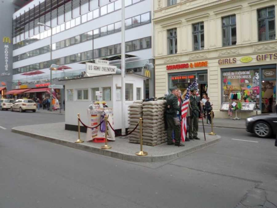 Checkpoint Charlie is a popular tourist attraction today. Visitors from the United States, France, the United Kingdom and Germany enjoy getting their photos taken at the former border crossing.