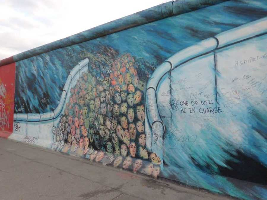 Each section of the Berlin Wall at the East Side Gallery depicts how society has overcome obstacles to democracy and freedom.