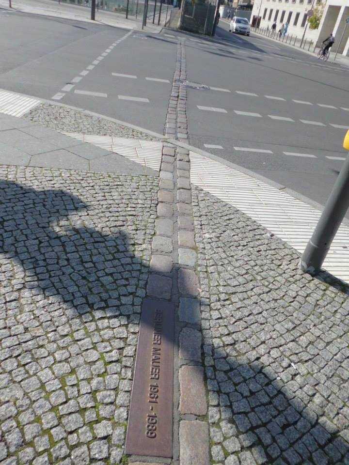"The commemorative cobblestones include a German inscription ""Berlin Wall 1961 - 1989."""