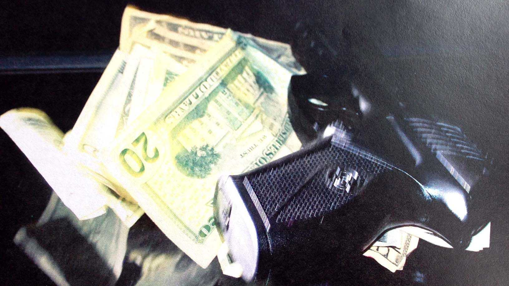 The gun and some cash found in car. The gun turned out to be an Airsoft pistol.