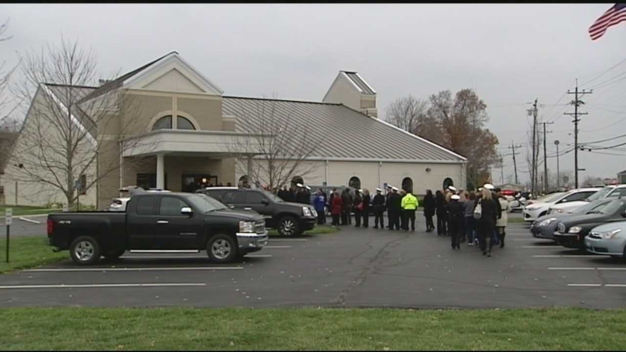 A Cincinnati police officer who passed away suddenly drew a crowd of co-workers, friends and family at his visitation Thursday.