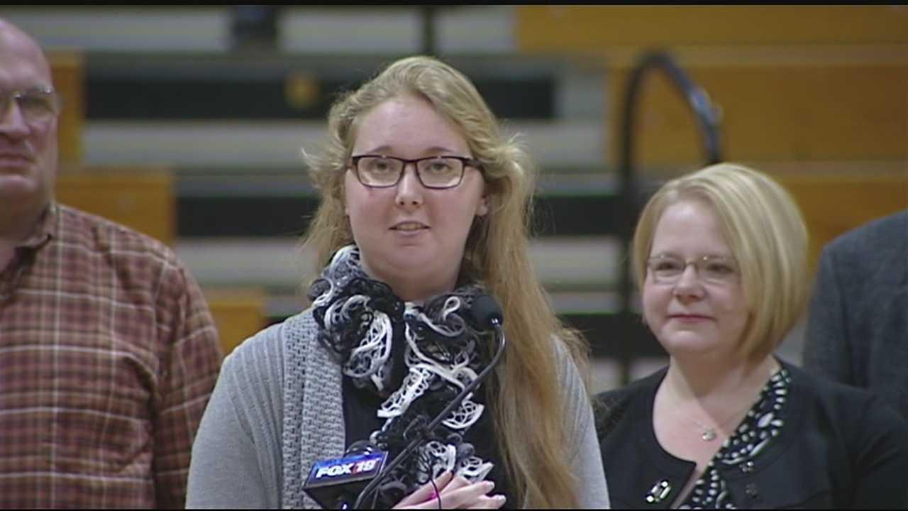 Lauren Hill presents money raised in her honor toward cure