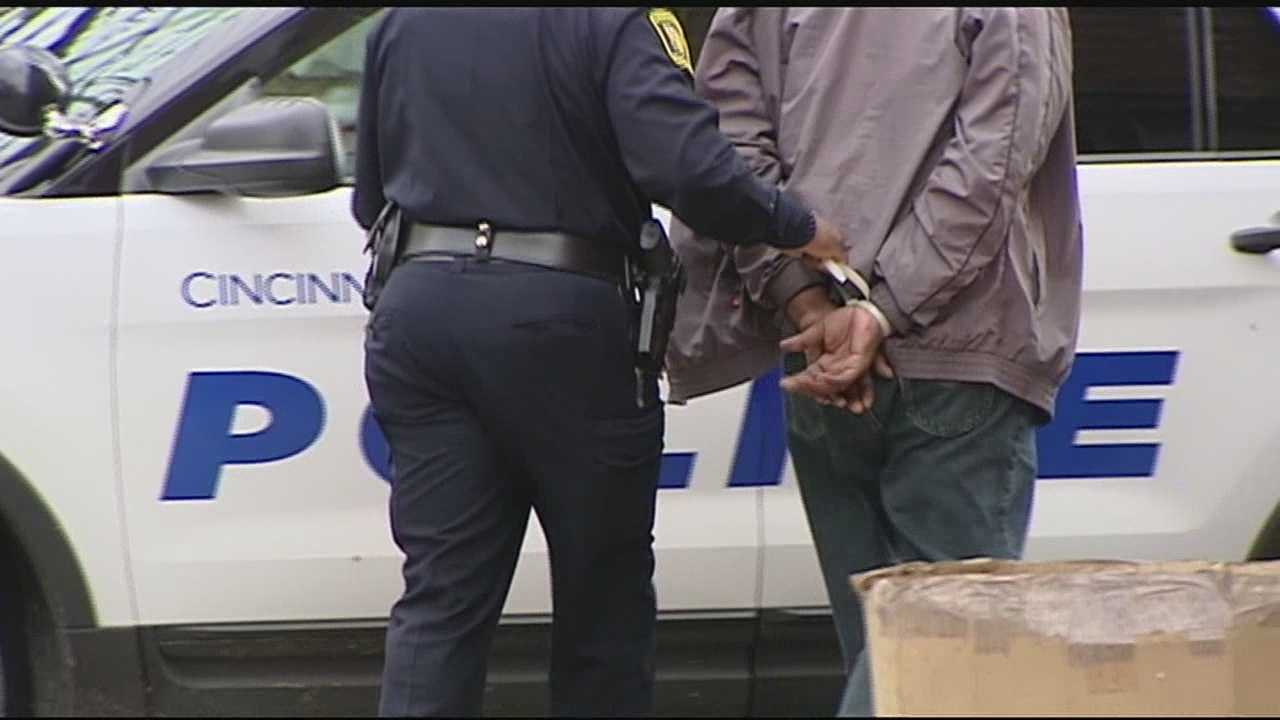 With guns drawn and warrants at the ready, SWAT officers and Cincinnati police hit the drug trade in the interior part of the city on Wednesday, looking for more than two dozen wanted men and women.
