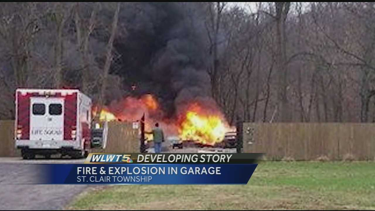Neighbors in St. Clair Township said they were startled by two loud explosions after a garage exploded Wednesday afternoon on Fear Not Mills Road.