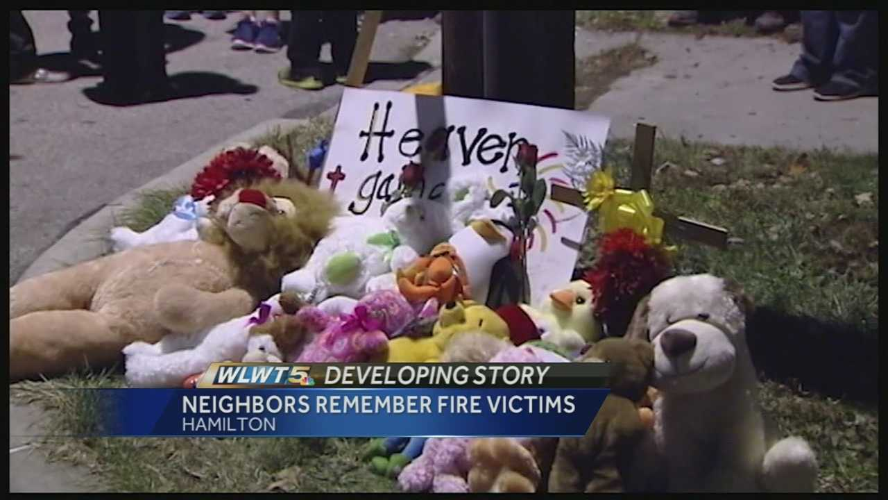 Friends and neighbors on Franklin Street gathered Friday night to remember the three children killed in a house fire.