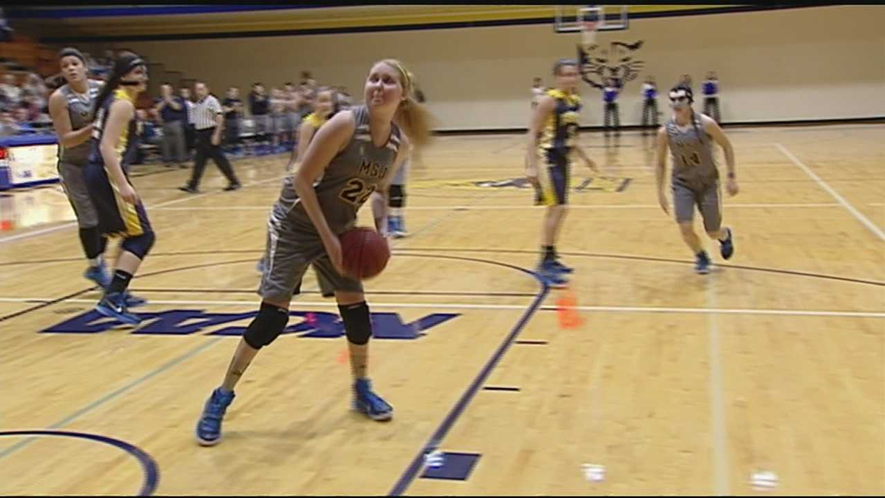 Mt. St. Joe's Lauren Hill scored the first basket in her team's game against Franklin College Saturday. She was diagnosed with terminal brain cancer and never expected to be well enough to play in the first home game.