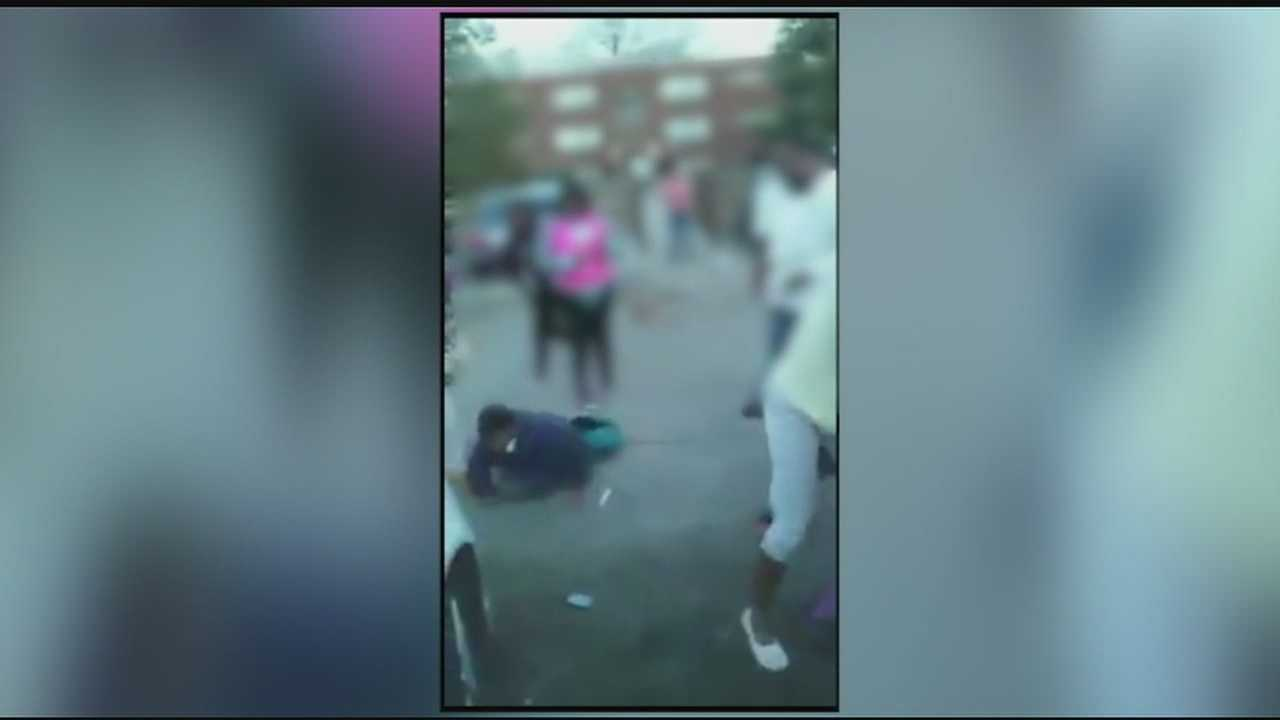 In a video posted to Facebook, teens are seen fighting before a man steps in and starts attacking students.