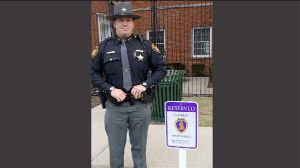 Sheriff's Deputy Danny Ruck at one of the parking spaces
