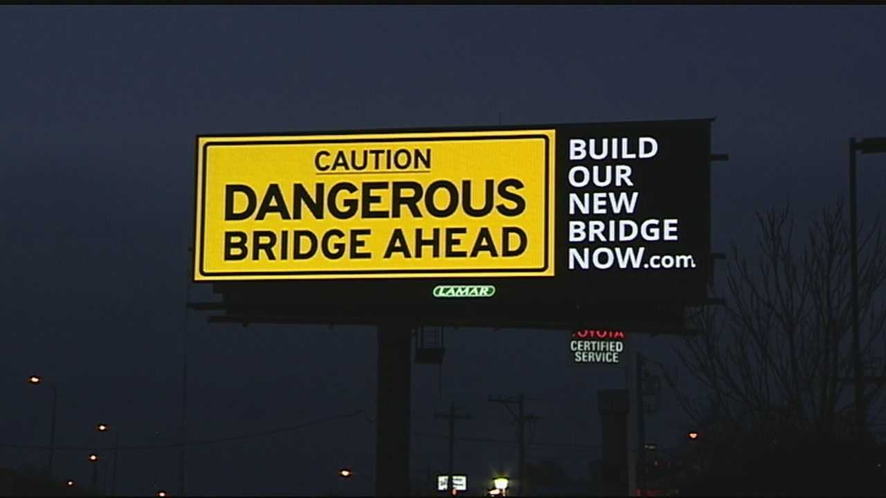 "A new billboard posted alongside the northbound lanes of I-75 just before the Brent Spence Bridge cautions drivers of a ""dangerous bridge ahead."" It's causing quite the controversy."
