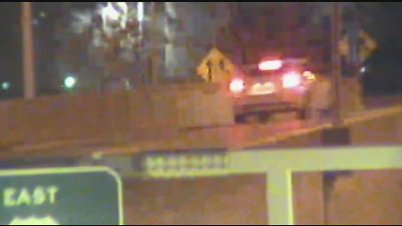 The images, taken at 12:56 a.m. on Dec. 27, show a 2013-2015 white Ford Fusion sedan on Fort Washington Way, about to get onto the entrance ramp of Interstate 71 around the time one of the shootings took place.