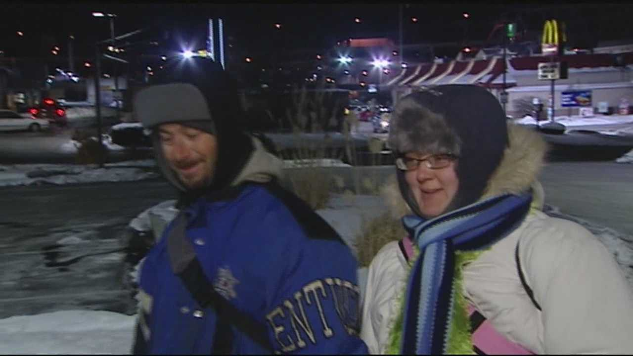 Charles Pyron and his wife, Crystal Pyron, were making their way back home on Thursday night, where there's no roof and no radiator, just lots of layers and each other.