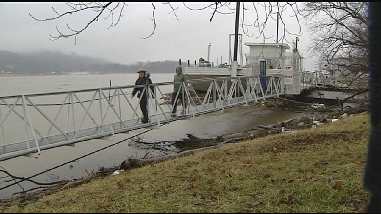 When the river crested Sunday just shy of 53 feet, the two anchor lines that kept Ohio River Launch Club out in the water broke. The marina went rushing to shore. A tow line on shore was the only thing that kept the marina from floating downriver.