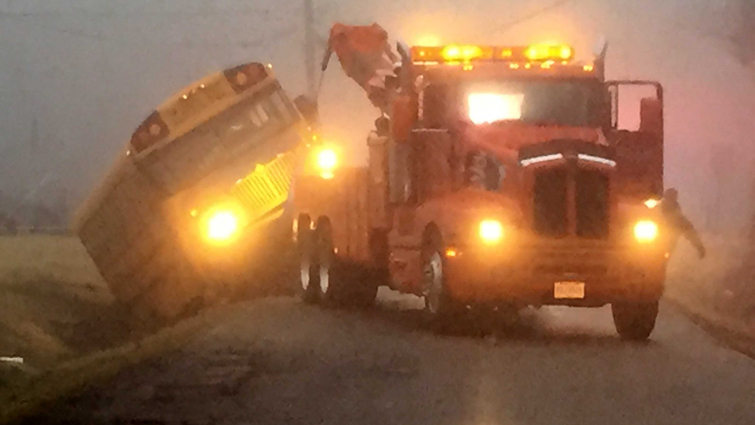 Tow truck works to pull bus out of ditch in Warren County