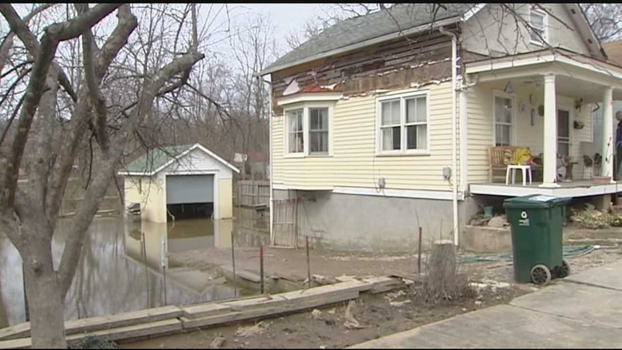 The river is below flood level, but mud is keeping it messy for homeowners along the river.