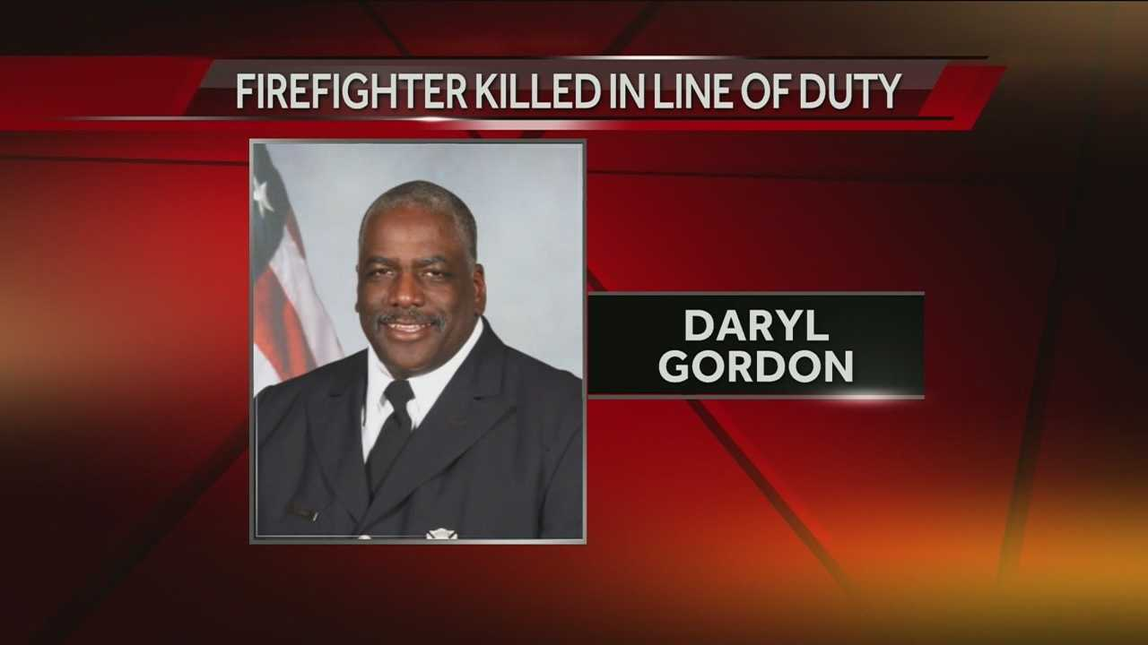 The fire chief said the firefighter, Daryl Gordon, 54, fell down an elevator shaft at the King Towers Apartments Thursday morning while responding with Heavy Rescue 14.