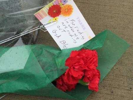 Mourners begin to leave flowers at The Greater Cincinnati Firefighter's Memorial Park.Watch this story