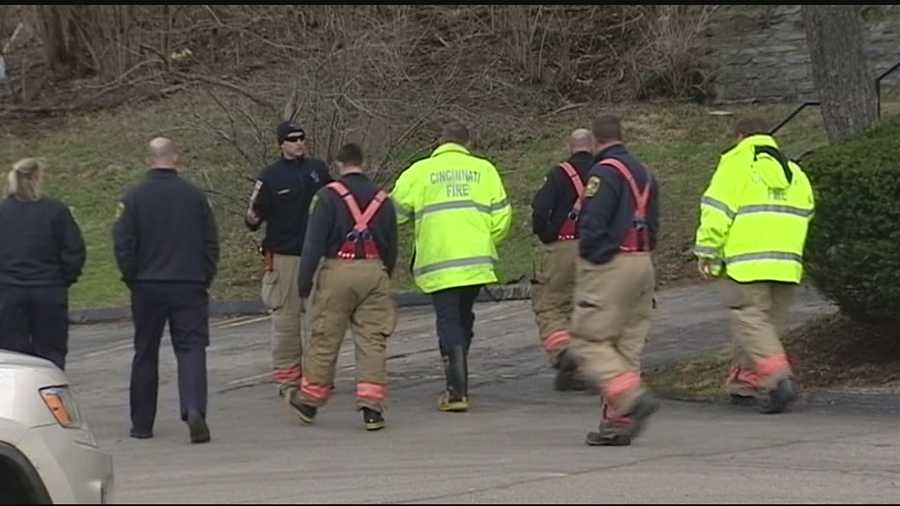 Friday afternoon: Firefighters meet at scene of of the fire to learn more about the investigationWatch this story