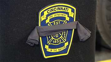 Firefighters across Greater Cincinnati wear black ribbons on their fire badges in memory of Gordon.