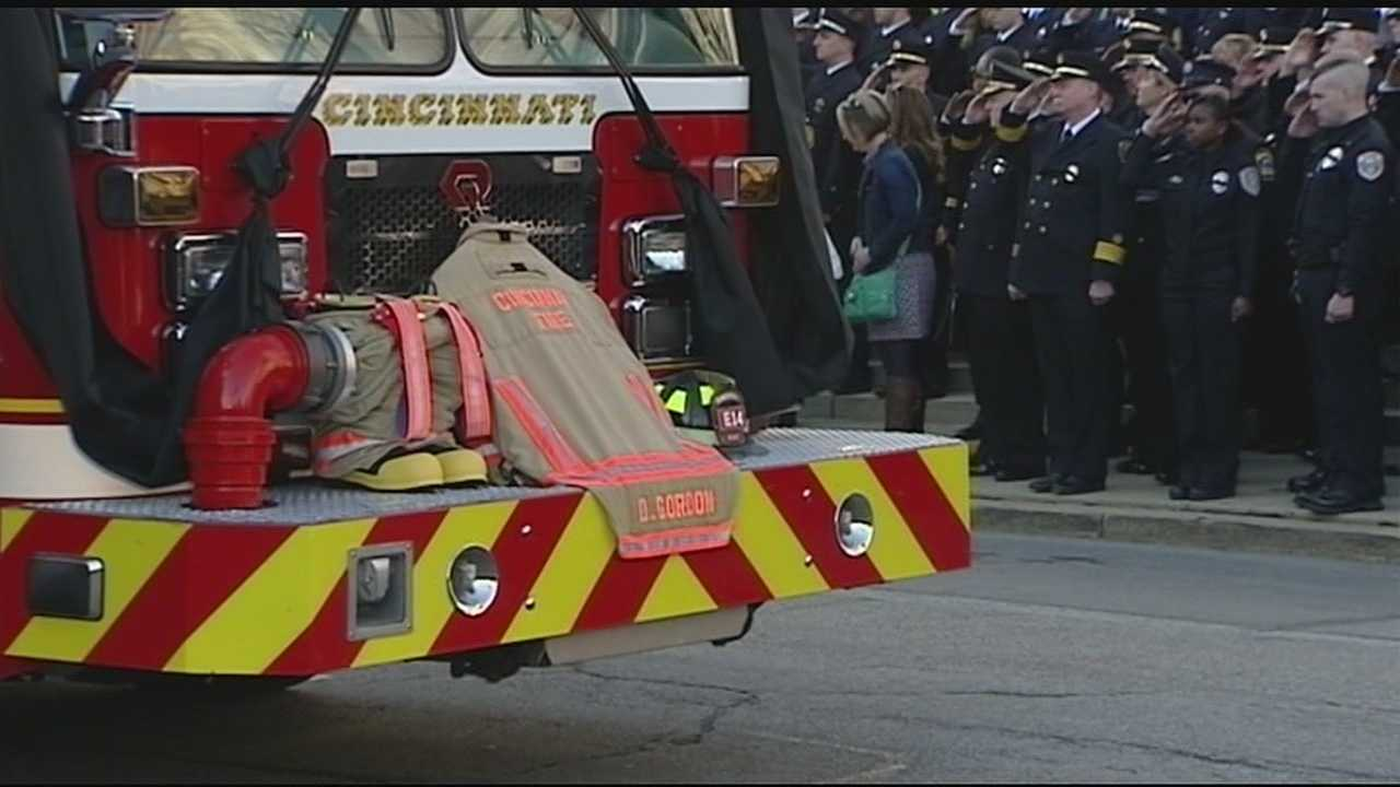 "Cincinnati's Mayor described the community as ""heartbroken"" today as firefighter Daryl Gordon was buried nearly a week after falling down an elevator shaft while trying to rescue others in a Madisonville fire."
