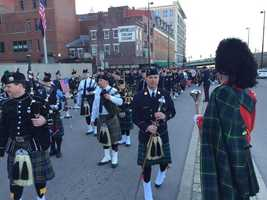 Dozens of bagpipe players accompany Gordon's procession.