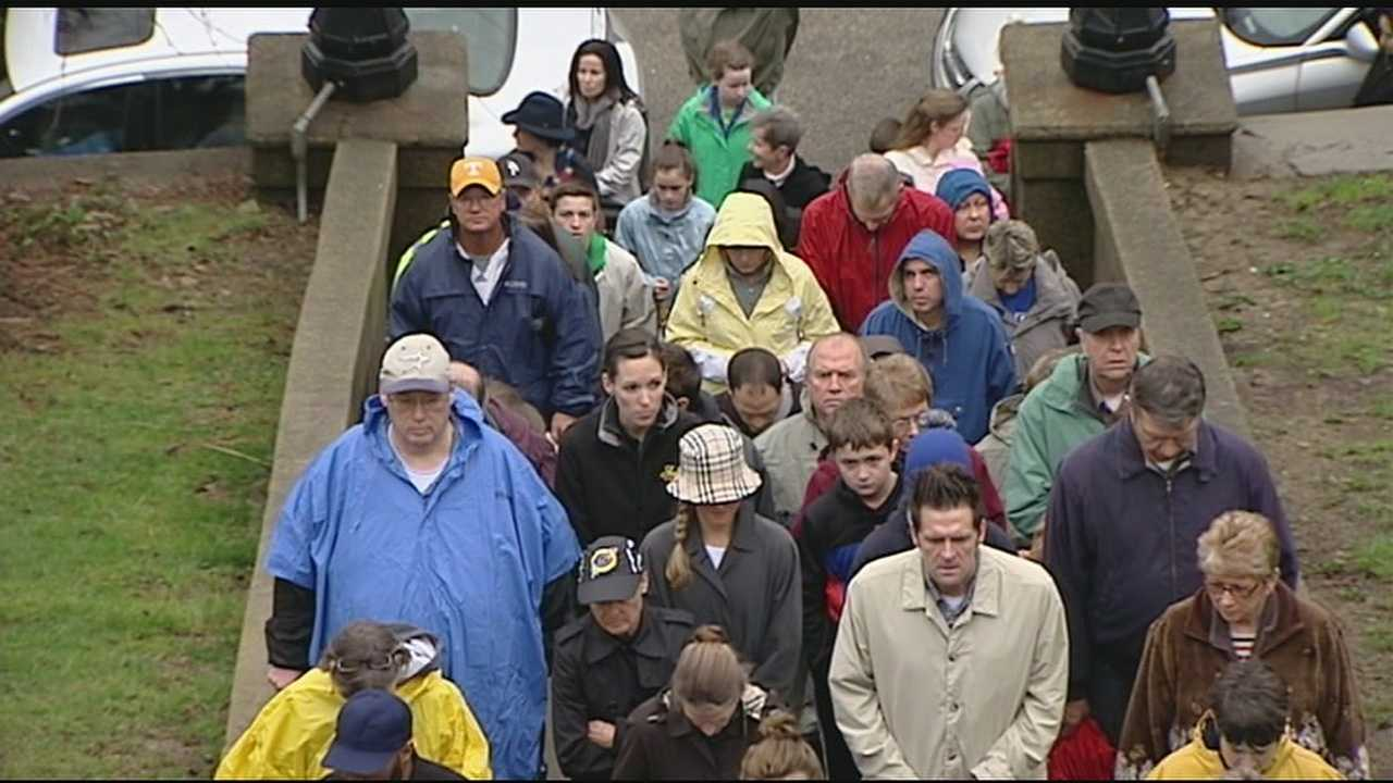 Despite the rain and storms, people lined up to pray the steps at Holy Cross Immaculata Church in Mount Adams.