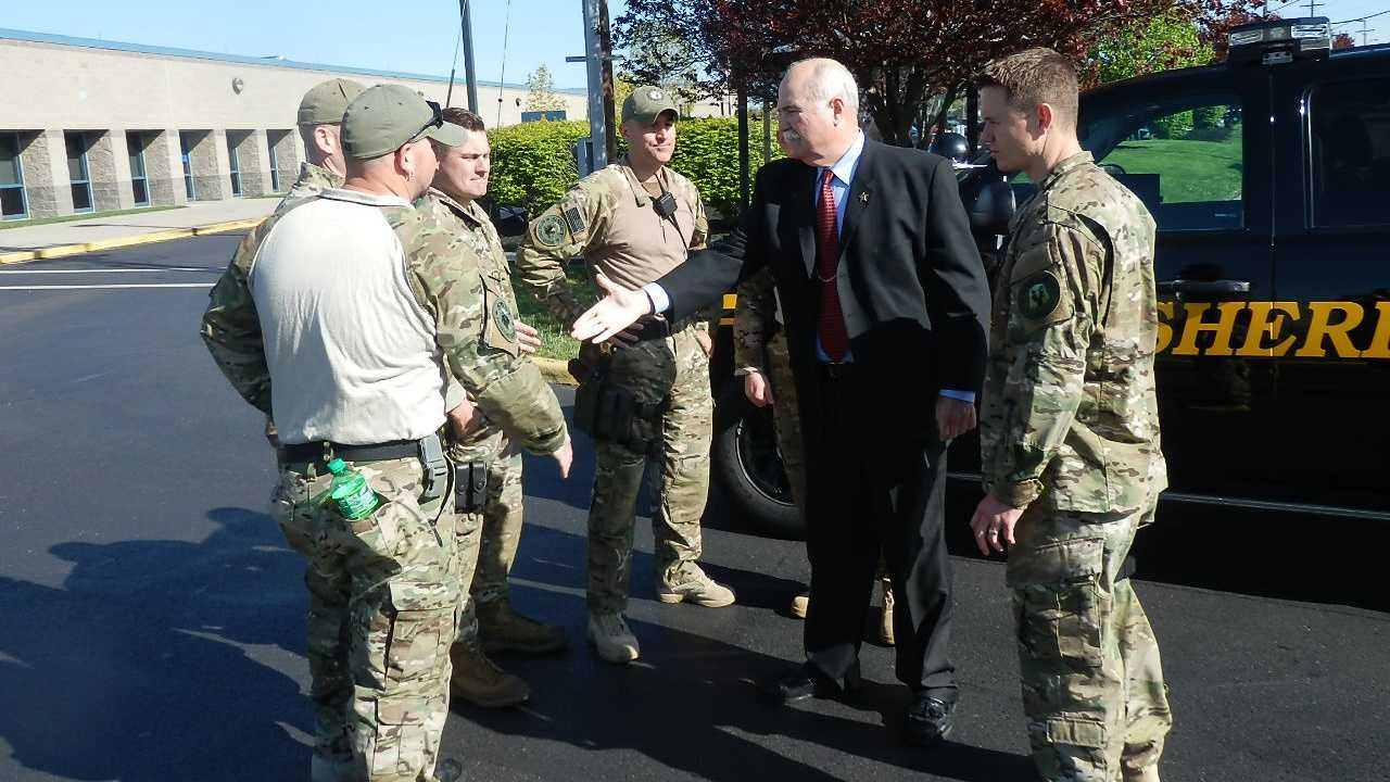 Jones sees off the SWAT members from the sheriff's office parking lot earlier this week.
