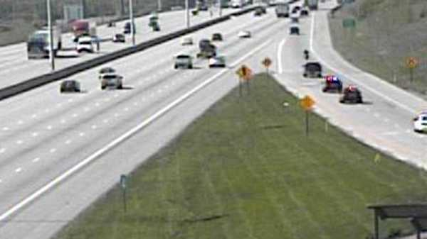 Black pickup enters I-75 SB from Ohio 63 with officers in pursuit (upper right)