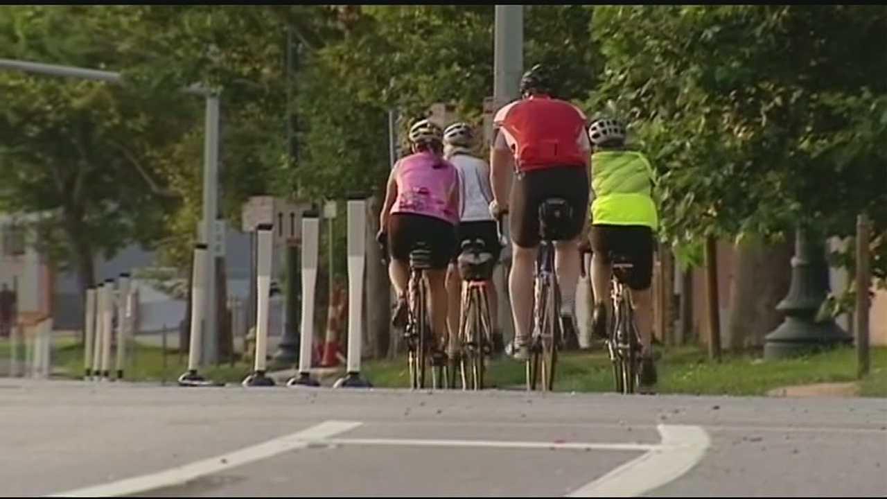 Cincinnati's neighborhoods committee agreed to buy 4.1 miles of unused railway for the Wasson Way bike trail.