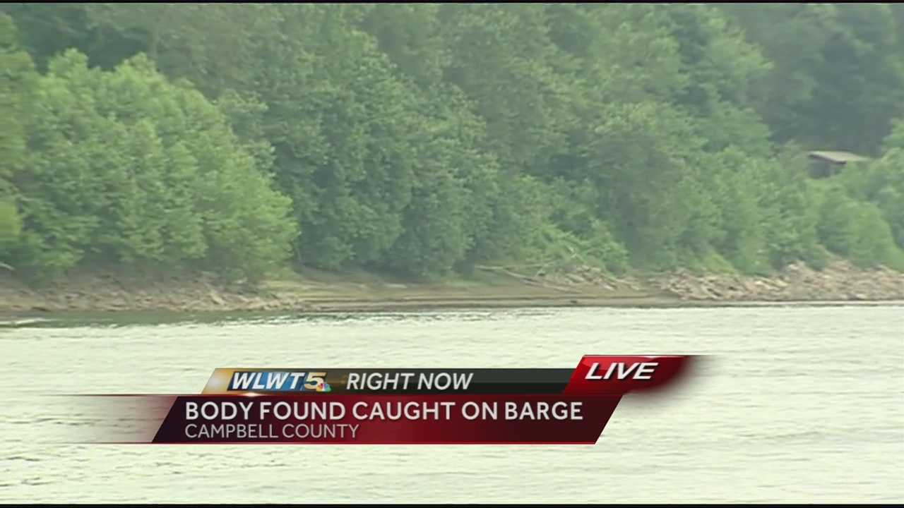 A man's body was recovered between two barges along a rocky ridge of the Ohio River.