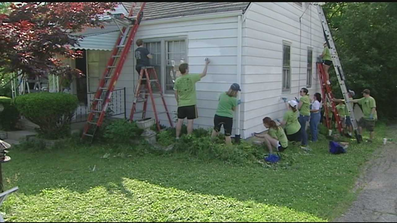 Volunteers brushed, taped and painted the town one house at a time. More than 35 houses got a fresh coat and a touch up at the 14th annual Paint the Town event on Saturday.