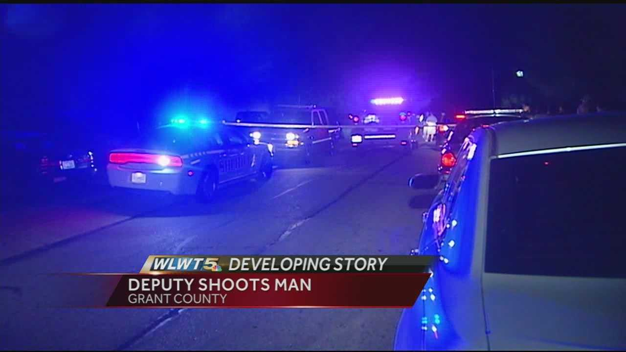 A man is hospitalized after troopers said he opened fire on a Grant Co. deputy.
