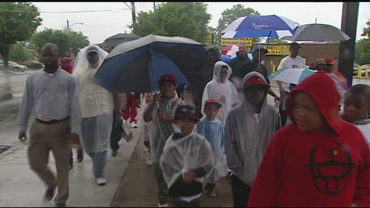 The group said rain does not deter violence, nor would it deter them. It was a gathering of men to reclaim as they say, their place in their community.