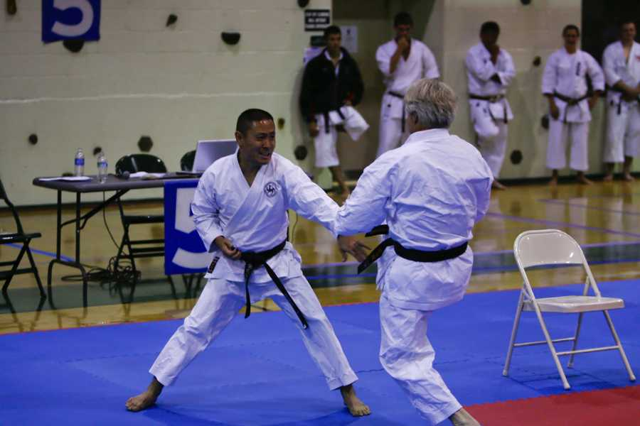 Friends remember Kim as a senei at Japanese Karate-do in Symmes Township. His students place flowers at the door of the Karate studio.Watch this story