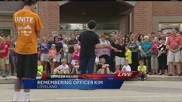 Saturday, June 20, 2015: Mourners hold a vigil for Kim outside Loveland Middle School.Watch this story
