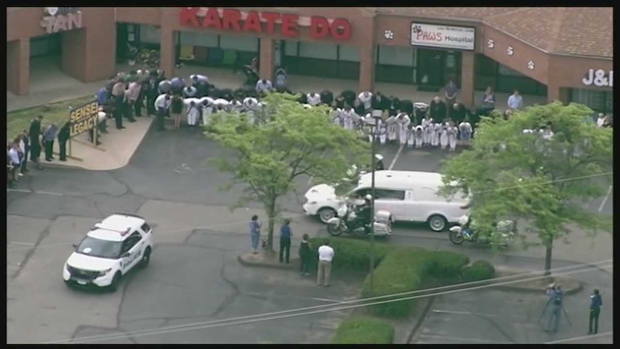 Fallen Cincinnati Police Officer Sonny Kim was laid to rest Friday. One of the most touching moments along the route was when Kim's hearse past his karate dojo where dozens of students and parents stood.