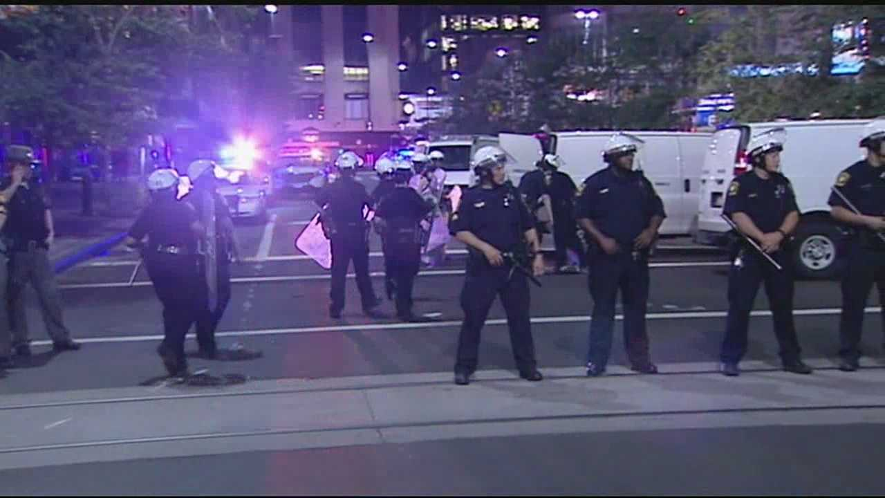 Two officers were injured as a night of holiday festivities ended in chaos Saturday at Fountain Square, police said. Cincinnati police made their way to the downtown area at about 11 p.m. just as Fourth of July events and the Reds game were wrapping up. Witnesses said police were directing crowds when a fight broke out among a group of youths.