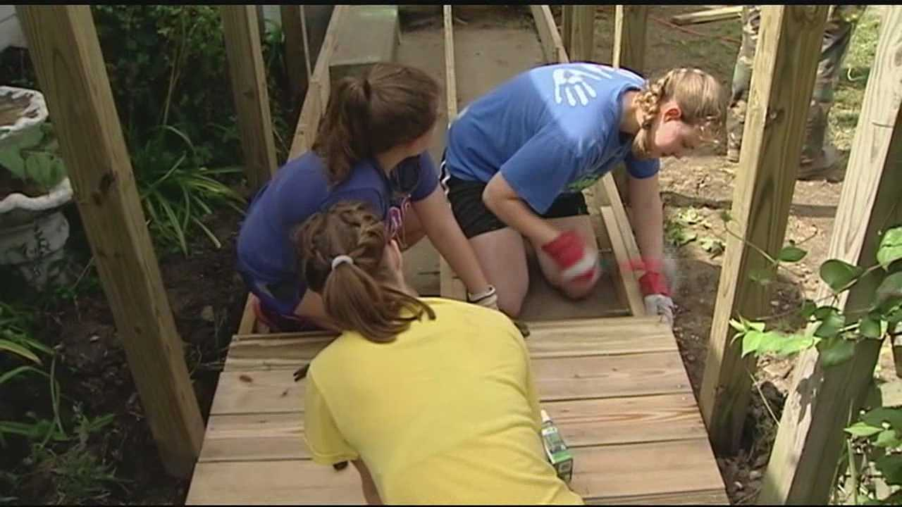 A group of young adults and their group leaders joined volunteers in Middletown for a home repair blitz.