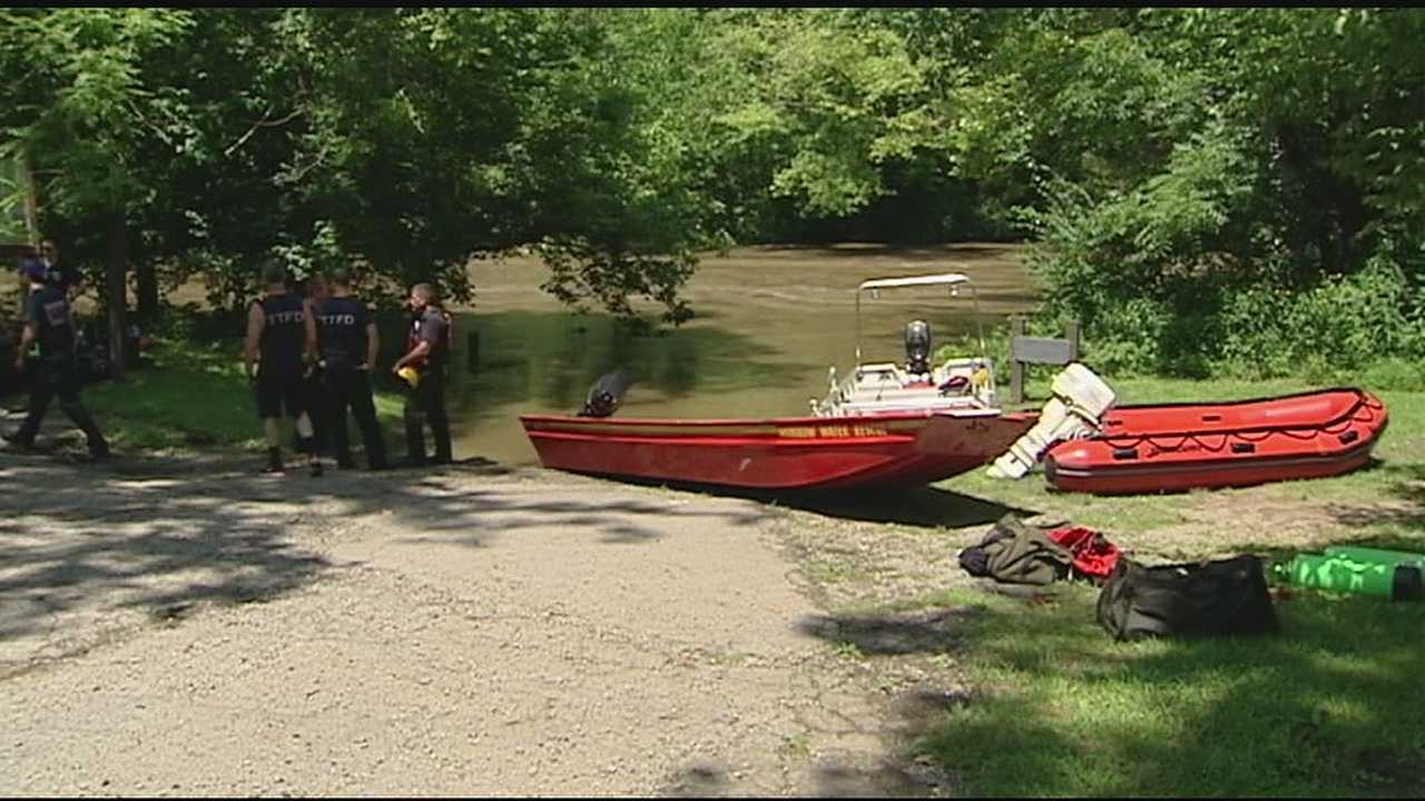 Dispatchers said the two were clinging to a tree in the river near Corwin Road near Oregonia just after noon.