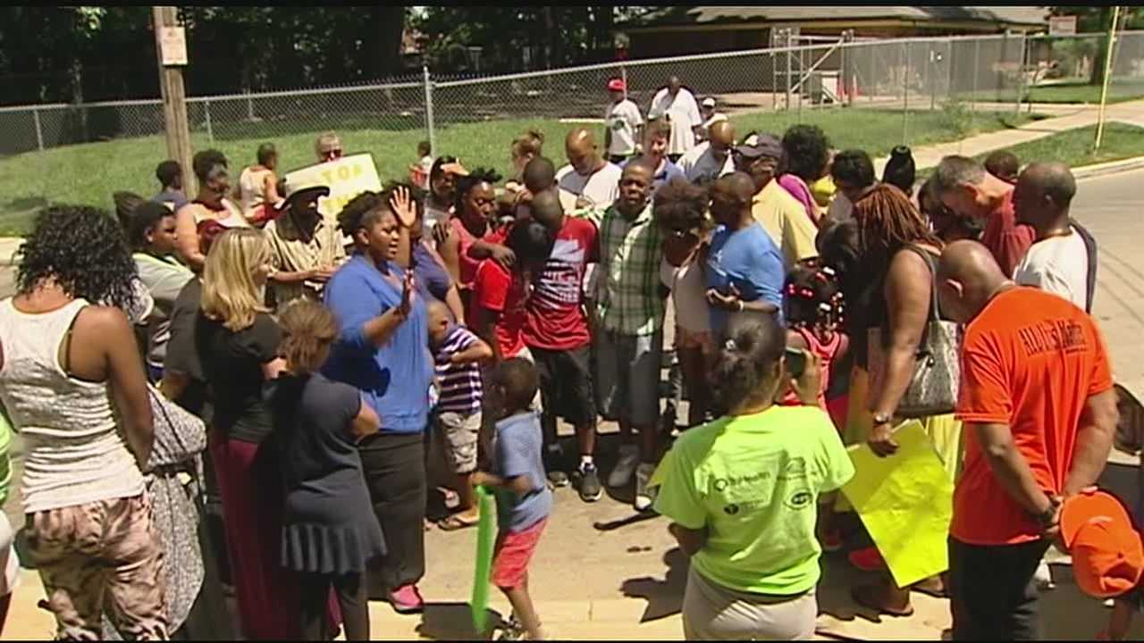 Residents in Avondale held a march Saturday after a little girl was caught in gunfire.