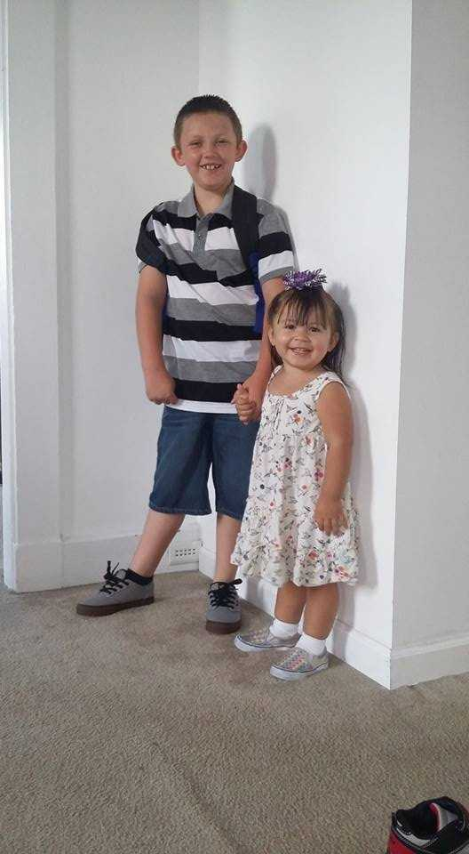 Peyton's first day of first grade, posing with his little sister!