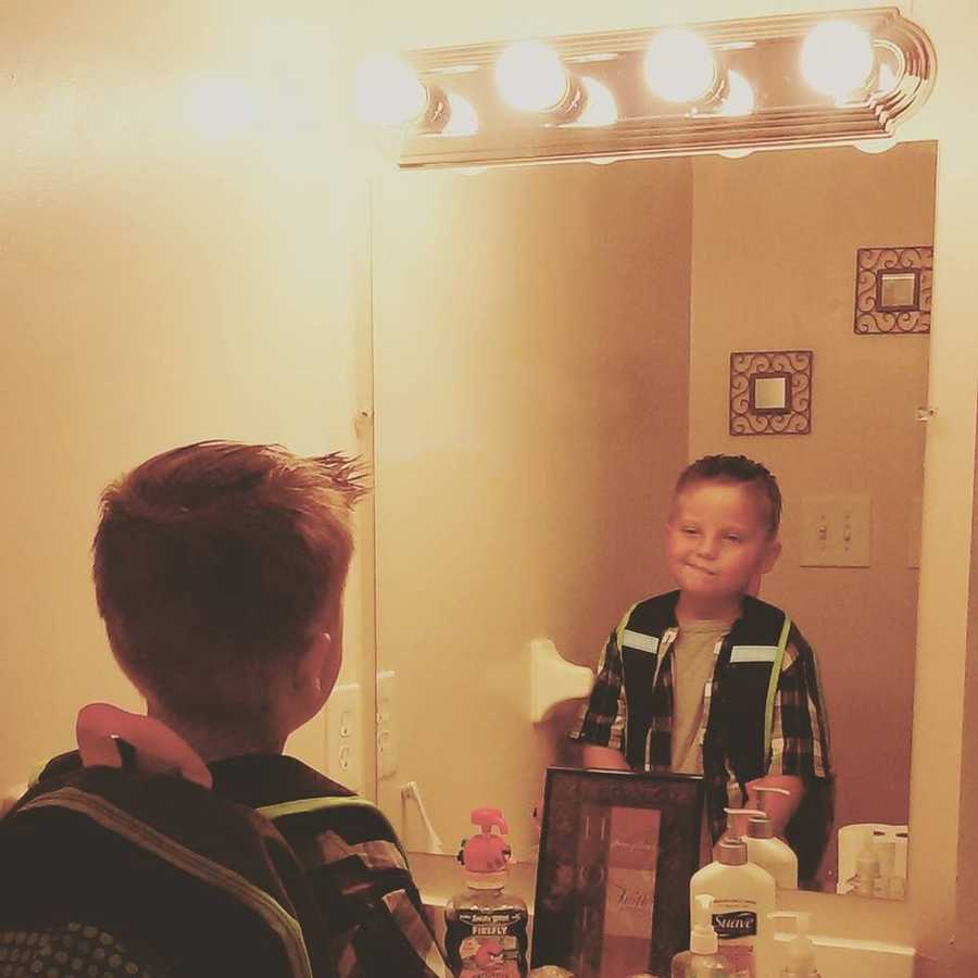 First day of first grade for Riley Christian! Gotta check himself in the mirror to make sure he looks cool!