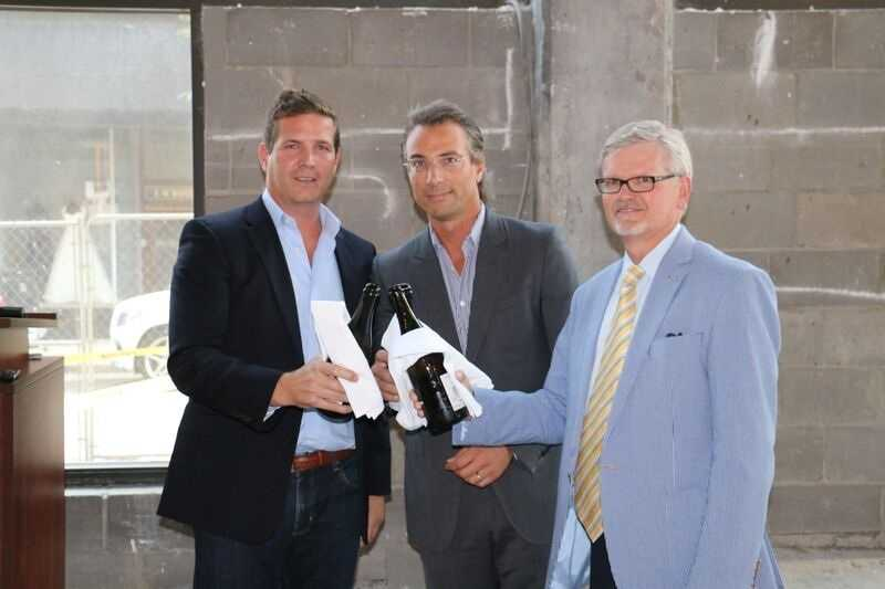 From left to right: Guy van Rooyen, president of The Salyers Group&#x3B; Mario Tricoci, CEO of Aparium Hotel Group&#x3B; Chuck Scheper, former mayor of Covington.