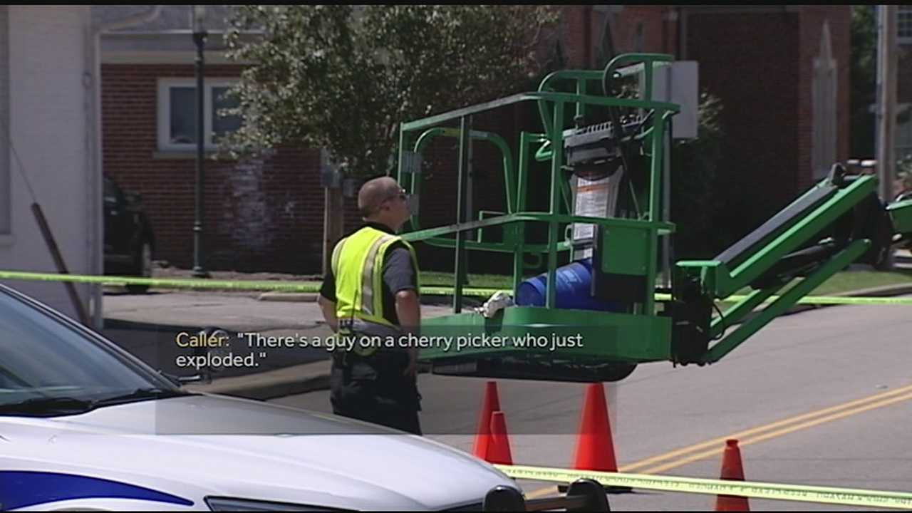 Witnesses of an accident involving two workers in a cherry picker describe the scene in 911 calls.