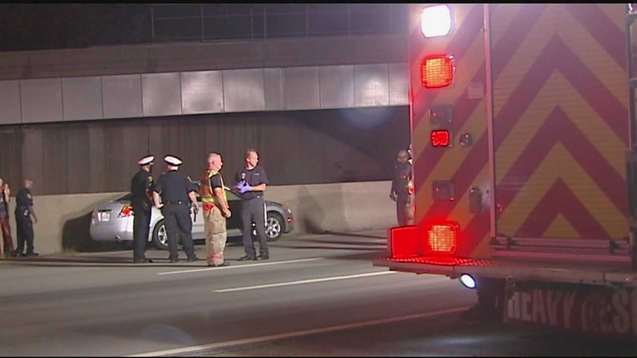 A car shot up by an assault rifle on one of the busiest stretches of interstate in Cincinnati, and Cincinnati police are trying to find the person who opened fire.The shooting happened on South I-75 near the Ezzard Charles Drive exit early Monday.